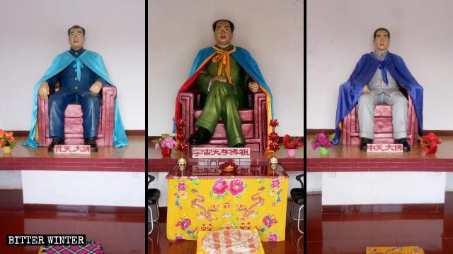 Mao Zedong wird von Statuen von Zhu De und Zhou Enlai umrahmt.